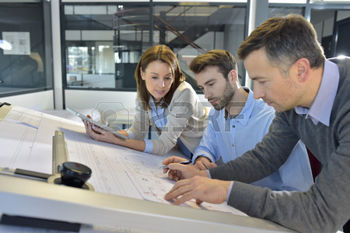 36000991-team-of-architects-working-on-construction-project
